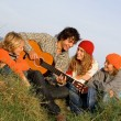 Mixed race family with guitar on vacation — Stock Photo #6361875