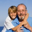 Child and grandfather - Stock Photo