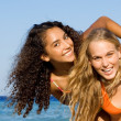 Piggyback fun on spring break or summer vacation - Stock Photo