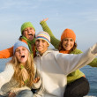 Group of happy teens singing - Stock Photo
