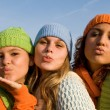 Group of girls blowing kisses - Stock Photo
