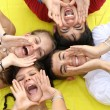 Group of happy teens shouting or singing - Stock Photo