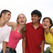 Happy group of teens or students — Stock Photo