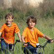 Healthy kids playing with bikes - Stock Photo