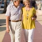 Active seniors walking on vacation in mallorca — Stock Photo