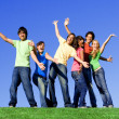 Piggyback diverse group teens — Stock Photo #6361995