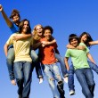 Piggyback diverse group teens — Stock Photo #6361996