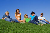 Group of teens students relaxing on campus — Stock Photo