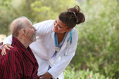 Nurse and patient home care (focus on man) — Stock Photo