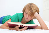 Christian child reading the bible — Stock Photo
