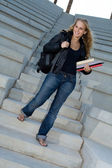 Happy student on college campus with books and backpack — Stock Photo
