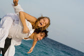 Happy piggyback couple on spring break or summer vacation — Stock Photo