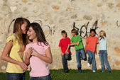 Mixed race kids hanging out together — Stock Photo