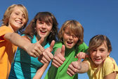 Group of kids with thumbs up — ストック写真