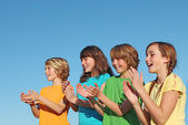 Group of kids, children, or supporters clapping — Stock Photo