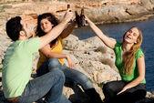 Underage teens drinking alcohol — Stock Photo