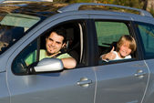 Father and kid in car road trip — Stock Photo