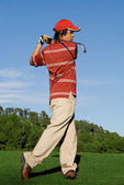 Golfer playing game of golf — Stock Photo