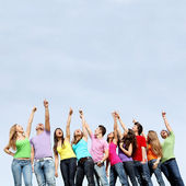 Group of teens pointing — Stockfoto