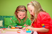Happy children playing drawing and making craft in class at kind — Stock Photo