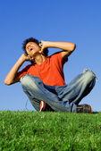 Teen boy singing listening to music with headphones — Stock Photo