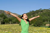 Child singing or shouting with arms raised, faith and praise — Stock Photo