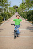 Confident child riding bike or bicycle — Stock Photo