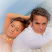 Couple laying on beach relaxing on summer vacation — Stock Photo