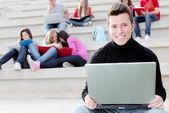 Boy university student with laptop or notebook — Stock Photo