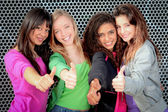 Happy diverse teen girls showing thumbs up — Stockfoto
