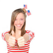 Beautiful American young woman celebrating 4th of july with flag — Stock Photo