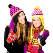 Happy smiling winter hat young women or girls — Stock Photo