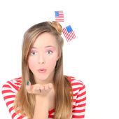 AMERICAN GIRL BLOWING WISHES OR KISSES CELEBRATING 4TH OF JULY — Stock Photo