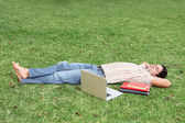 Student relaxing on campus — Stock Photo
