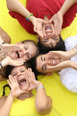 Group of happy teens shouting or singing — Stock Photo