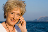 Senior woman with cell or mobile phone — Stock Photo