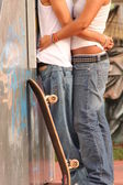 Teens in skate park, first love — Stock Photo