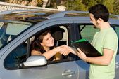 Passed driving, exam or buying or hiring, new car. — Stock Photo