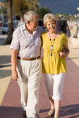 Active seniors walking on vacation in mallorca — Stock Photo