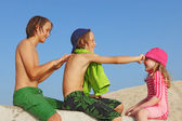 Summer vacation kids with sun protection cream — Stock Photo