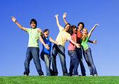 Piggyback diverse group teens — Stock Photo