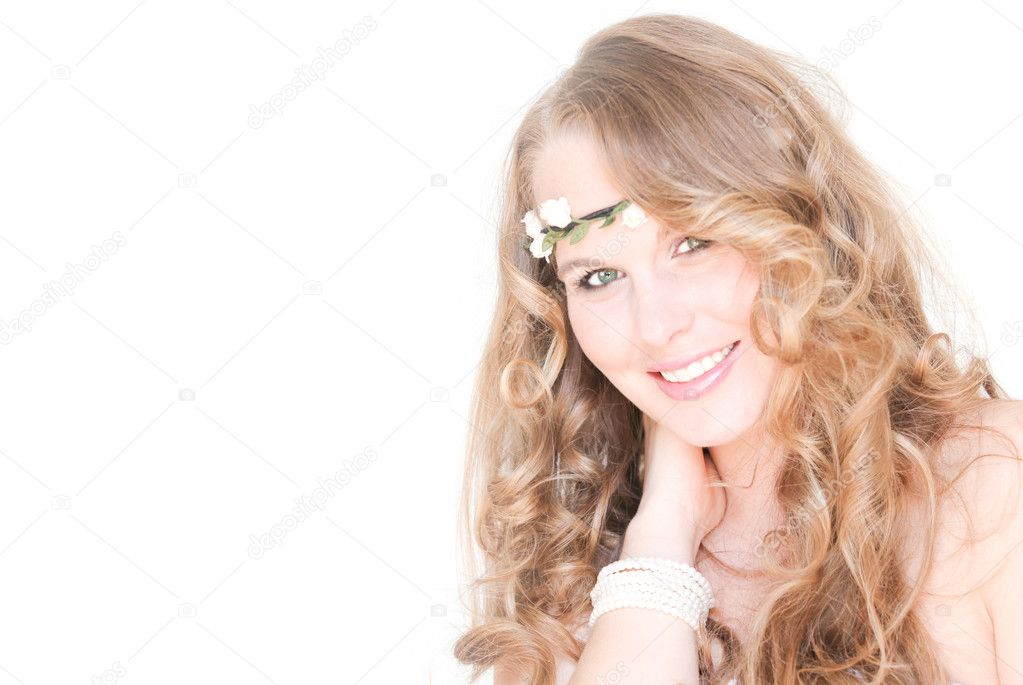 Smiling blonde with beautiful healthy hair and flowers — Stock Photo #6361433