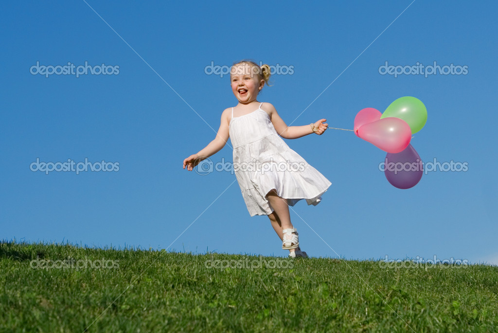 Happy summer child running outdoors with balloons  Stock Photo #6361446
