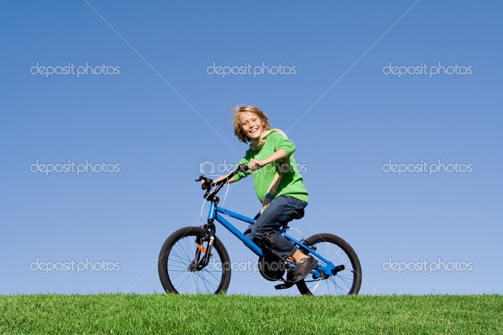 Healthy happy kid playing outdoors riding bike — Stock Photo #6361569