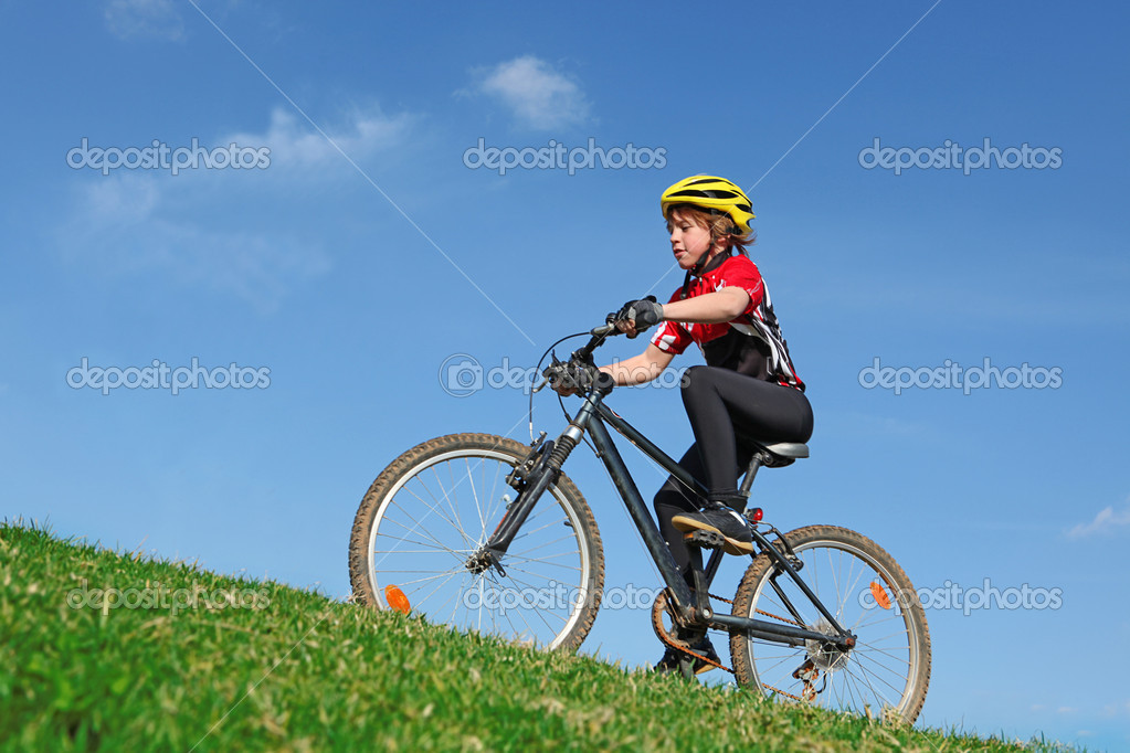 Healthy fit child riding bike — Stock Photo #6361625