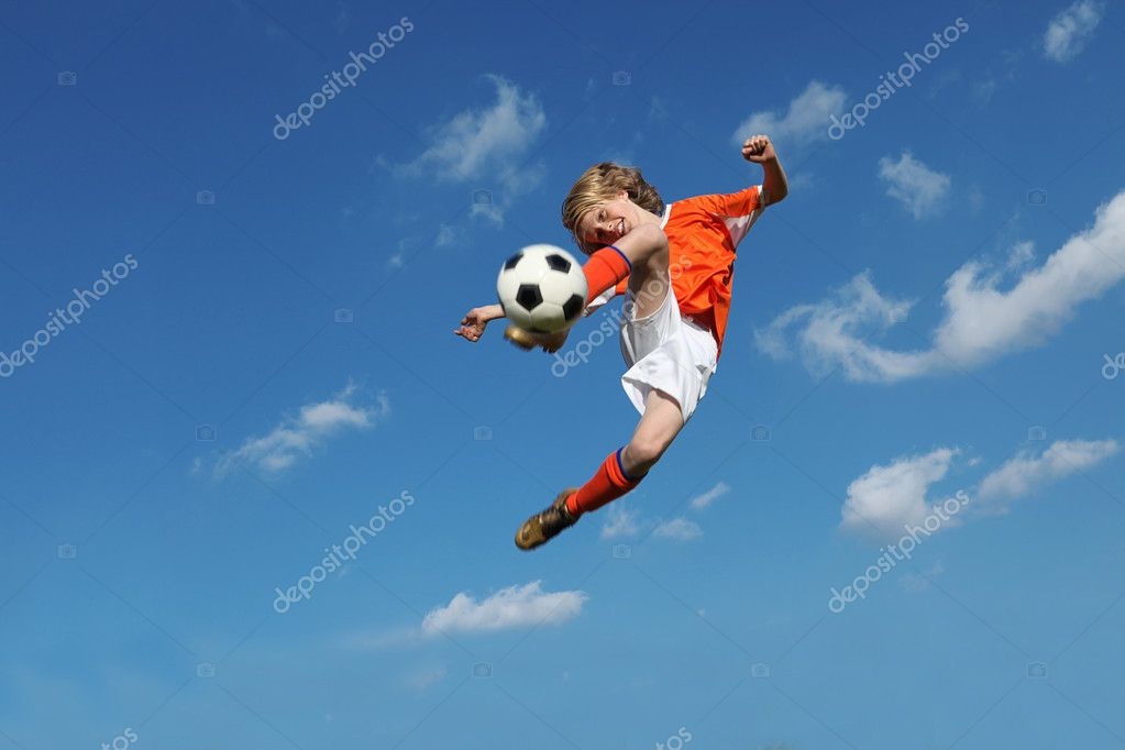 Child playing football or soccer — Stok fotoğraf #6361628