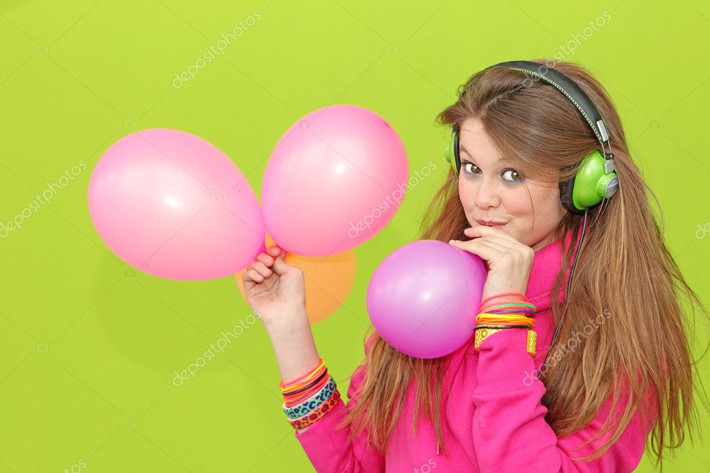 Happy girl blowing up balloons at party — Stock Photo #6361672