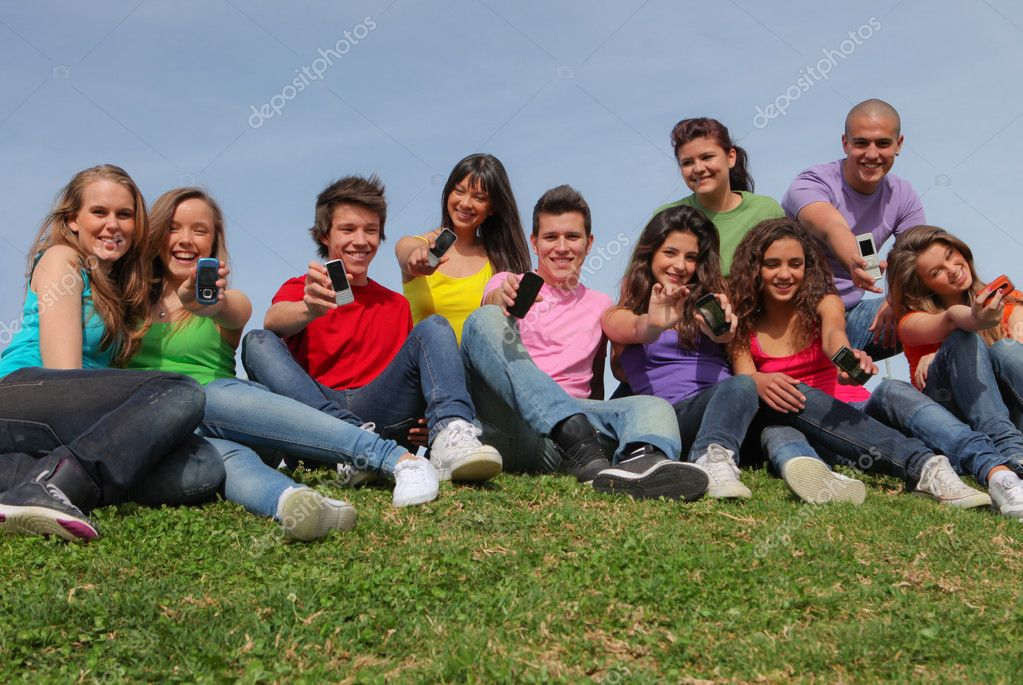 Group of mixed race showing cell phone or mobile telephones  Stock Photo #6361782