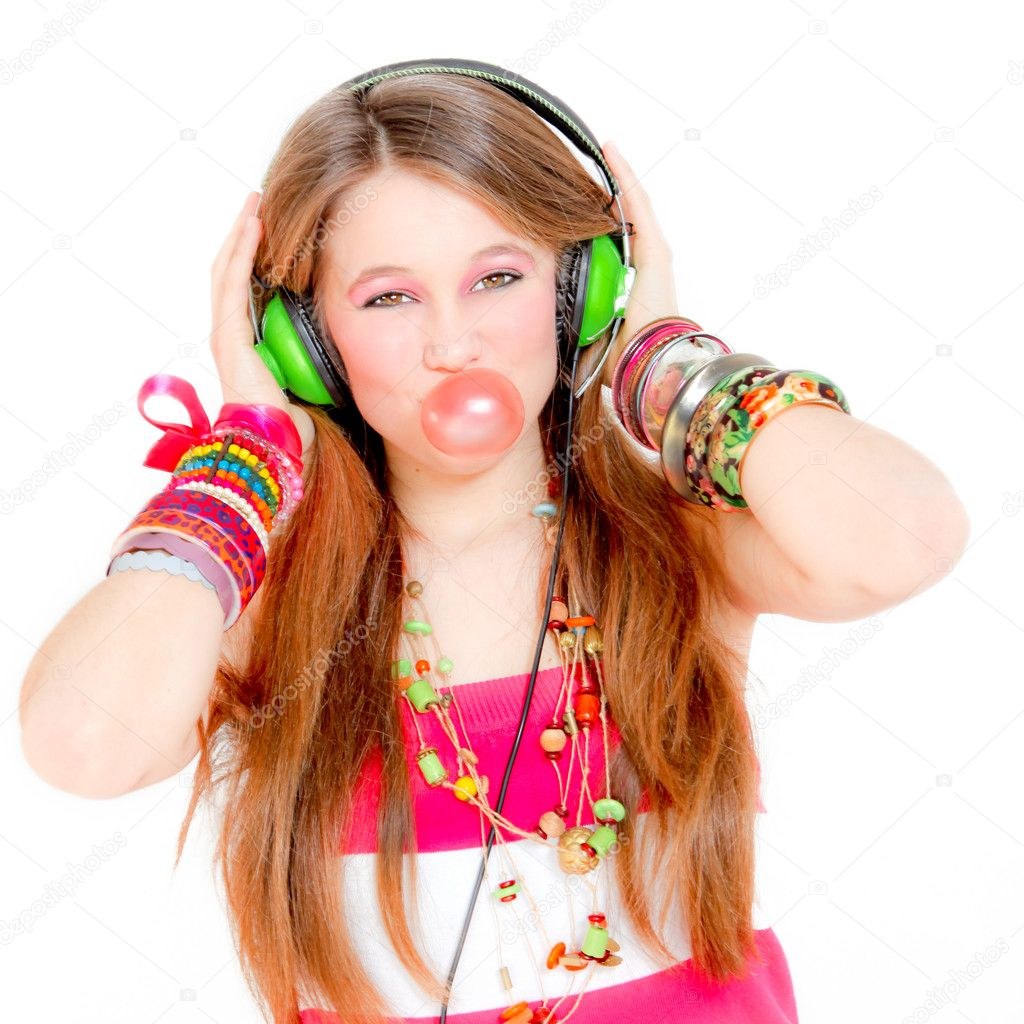 Funky girl listening to music and blowing bubble with gum  Stock Photo #6361797