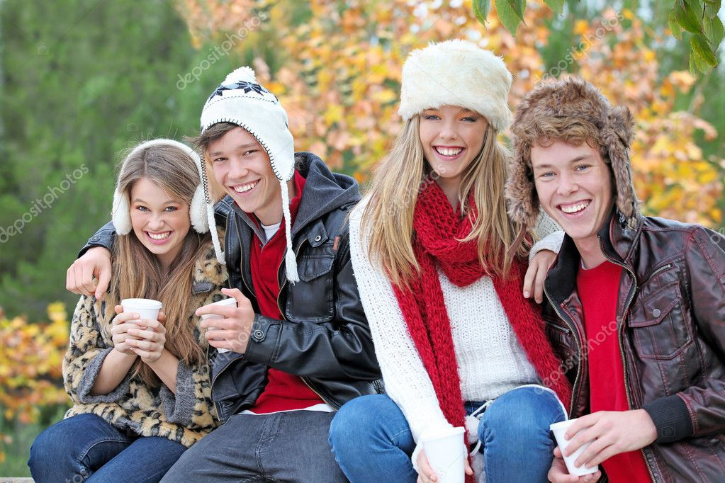 Happy autumn or fall group of smiling teens — Stockfoto #6361812
